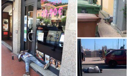Stanchi ma soprattutto ubriachi: così la strada diventa un comodo materasso per dormire